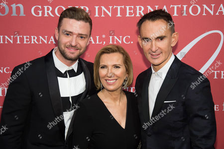 Justin Timberlake, left, Liz Rodbell and Neil Barrett attend the Fashion Group International's Night of Stars Gala at Cipriani Wall Street, in New York