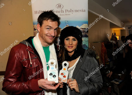 Brad Johnson, left, and Shannon Kay hold a txtRng stylus at the Fender Music lodge during the Sundance Film Festival, in Park City, Utah