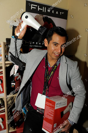 Stock Photo of Actor Eloy Mendez visits the FHI HEAT hair tools booth at the Fender Music lodge during the Sundance Film Festival, in Park City, Utah