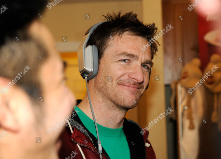Brad Johnson wears Inspiration headphones by Monster Products at the Fender Music lodge during the Sundance Film Festival, in Park City, Utah
