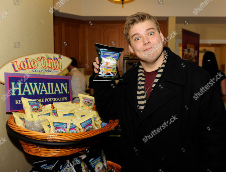 Actor Andrew Caldwell visits the Tim's Cascade Snacks Hawaiian Kettle Style Potato Chips booth at the Fender Music lodge during the Sundance Film Festival, in Park City, Utah
