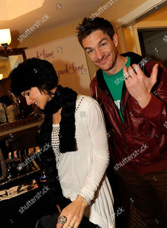 Brad Johnson, right, and Shannon Kay visit the Park Lane jewelry booth at the Fender Music lodge during the Sundance Film Festival, in Park City, Utah