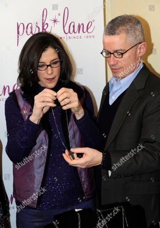 Director Alexandra Pelosi, left, and former New Jersey Gov. Jim McGreevey visit Park Lane jewelry at the Fender Music lodge during the Sundance Film Festival, in Park City, Utah