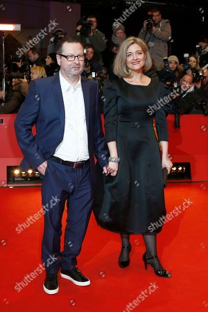 Stock Image of Director Lars von Trier and his wife Bente Froge pose for photographers on the red carpet for the film Nymphomaniac at the International Film Festival Berlinale in Berlin