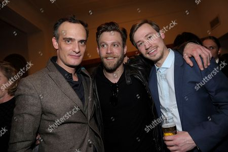 From left, Anatole Taubman, Ken Duken and David Kross attend The Hollywood Reporter party held at Borchardt's Restaurant to celebrate the 2014 Berlin International Film Festival with Studio Babelsberg and Audi,, in Berlin