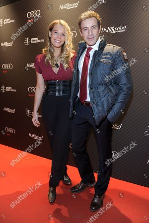 Actor Gedeon Burkhard (right) and Anika Bormann attend The Hollywood Reporter party held at Borchardt's Restaurant to celebrate the 2014 Berlin International Film Festival with Studio Babelsberg and Audi,, in Berlin