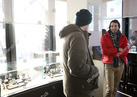 Director Alex Ross Perry, right, chats with actor Keith Poulson, in the Hollywood Reporter & Glashütte Lounge, at the Berlin Film Festival,, in Berlin, Germany