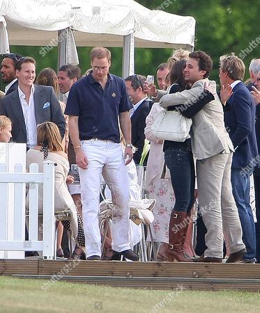 Stock Photo of Prince William and Catherine Duchess of Cambridge hugging Thomas Van Straubenzee