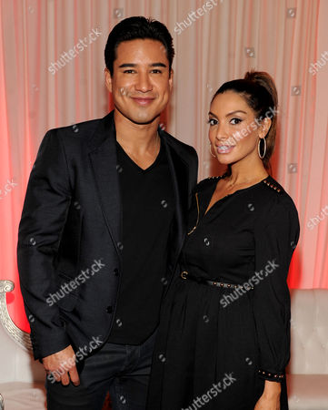"From left, host Mario Lopez and wife Courtney Laine Mazza attend FOX's ""The X Factor"" Season 3 Finalists Party,, at the SLS Hotel in Beverly Hills, Calif"
