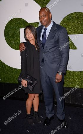 Actor and comedian Dave Chappelle, left, and his wife Elaine Chappelle attend the 2014 GQ Men of the Year Party at Chateau Marmont in Los Angeles on