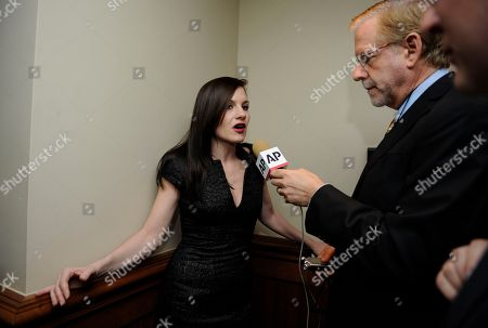 "Stock Photo of Songwriter/producer and former ""American Idol"" judge Kara DioGuardi, left, is interviewed at the Grammy's on the Hill Awards at The Hamilton on in Washington"