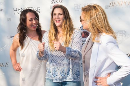 Stock Image of Samantha Yanks, from left, Drew Barrymore, middle, and Debra Halpert attend Hamptons Magazine Memorial Day Soiree at a private estate in Sagaponack, in New York