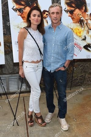 "Stock Image of Dan Abrams, right, and Florinka Pesenti attend a special screening of ""Mission Impossible: Rogue Nation"" at the United Artists East Hampton Cinema 6, in East Hampton, NY"