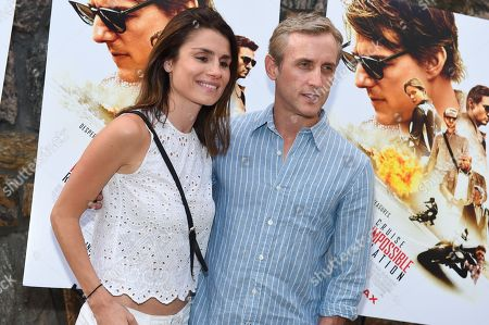 """Dan Abrams, right, and Florinka Pesenti attend a special screening of """"Mission Impossible: Rogue Nation"""" at the United Artists East Hampton Cinema 6, in East Hampton, NY"""