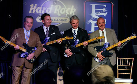 Jim Allen, Chairman, Hard Rock International, left, Eugene J. Cassidy, CEO, Eastern States Exposition, Donald R. Chase, Chairman, Eastern States Exposition, and Hamish Dodds, right, CEO, Hard Rock International, celebrate the announcement of Hard Rock International's application submission for Hard Rock Hotel & Casino New England at Eastern States Exposition by presenting custom guitars in West Springfield, Mass., on