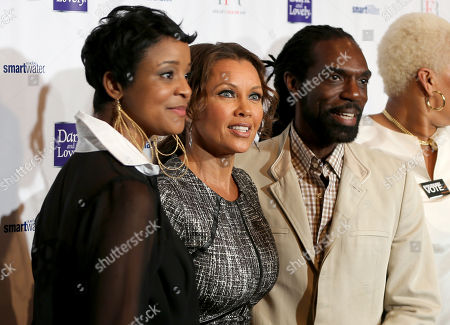 From left, Brandice Henderson, Vanessa Williams, and designer Kevan Hall are seen at Harlem's Fashion Row 5th Anniversary Fashion Show, on in New York