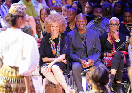 A model walks past Michaela Angela Davis, left, and Carl Nelson are seen at Harlem's Fashion Row 5th Anniversary Fashion Show, on in New York