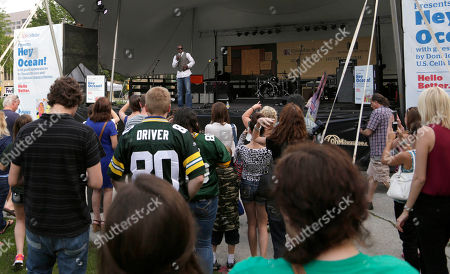 Green Bay Packer all-time leading receiver, Super Bowl Champion and Dancing with the Stars Champion Donald Driver introduces Hey Ocean! at a free concert in Cathedral Square Park presented by U.S. Cellular. in Milwaukee, Wis