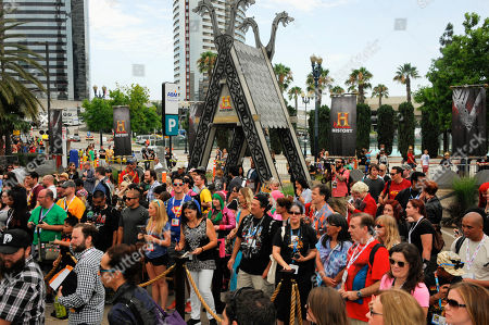 """IMAGE DISTRIBUTED FOR CIVIC ENTERTAINMENT GROUP - Fans line up to meet the cast of HISTORY's """"Vikings"""" at All Hail Vikings: An Interactive Experience outside the 2013 Comic-Con International Convention on in San Diego. Throughout the weekend, fans competed in longboat races in a custom 50-foot waterway, met with cast members and received a limited edition comic book written by series creator Michael Hirst"""