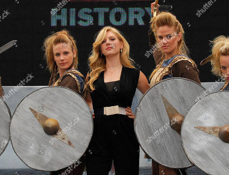 """Katheryn Winnick of HISTORY's """"Vikings"""" poses with Shield Maidens at All Hail Vikings: An Interactive Experience outside the 2013 Comic-Con International Convention on in San Diego. Throughout the weekend, fans competed in longboat races in a custom 50-foot waterway, met with cast members and received a limited edition comic book written by series creator Michael Hirst"""