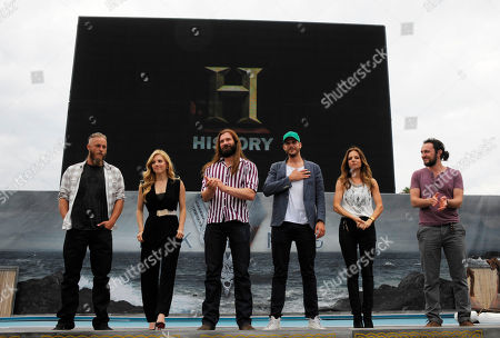 """Cast members of HISTORY's """"Vikings"""" pose on stage at All Hail Vikings: An Interactive Experience outside the 2013 Comic-Con International Convention on in San Diego. Throughout the weekend, fans competed in longboat races in a custom 50-foot waterway; met with cast members; and received a limited edition comic book written by series creator Michael Hirst"""