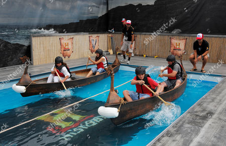 """Stock Picture of Fans take part in Viking longboat races at HISTORY's """"Vikings"""" All Hail Vikings: An Interactive Experience outside the 2013 Comic-Con International Convention on in San Diego. Throughout the weekend, fans competed in longboat races in a custom 50-foot waterway, met with cast members and received a limited edition comic book written by series creator Michael Hirst"""