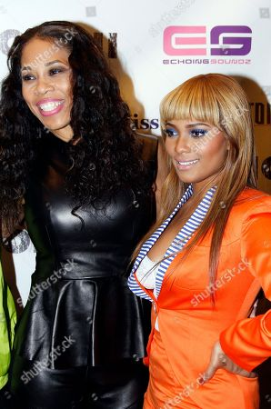 Stock Picture of Recording artist Doll Phace and Teairra Mari attend Holla II Movie Premiere - NYC on Wed, at AMC Empire 25 in New York. NY