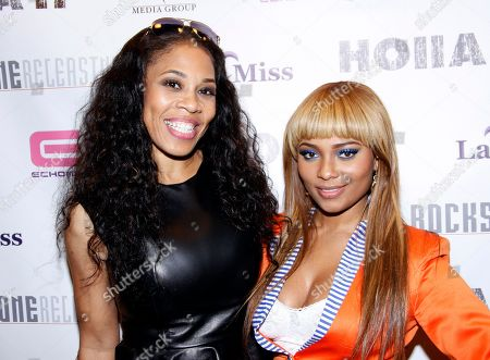 Recording artists Doll Phace and Teairra Mari attend Holla II Movie Premiere - NYC on Wed, at AMC Empire 25 in New York. NY