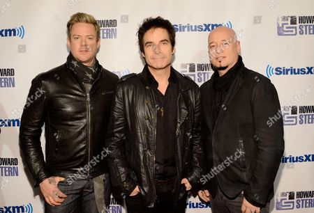"The band Train, from left, Scott Underwood, Pat Monahan and Jimmy Stafford attend ""Howard Stern's Birthday Bash"", presented by SiriusXM, at the Hammerstein Ballroom on in New York"