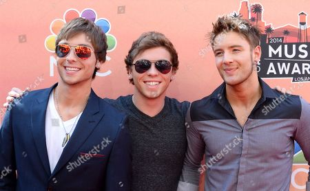Wesley Stromberg and from left, Keaton Stromberg and Drew Chadwick, of the musical group Emblem3, arrive at the iHeartRadio Music Awards at the Shrine Auditorium, in Los Angeles