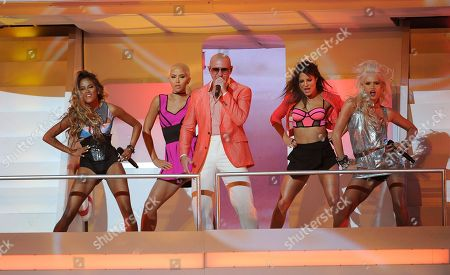 Pitbull, center, and from left, Paula Van Oppen, Emmalyn Estrada, Natasha Slayton and Lauren Bennett, of G.R.L., perform at the iHeartRadio Music Awards at the Shrine Auditorium, in Los Angeles