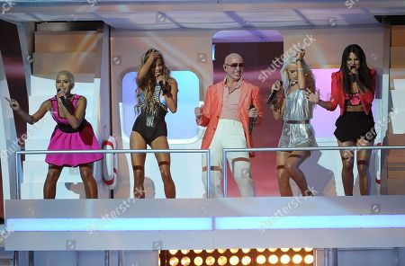 Pitbull, center, and from left, Paula Van Oppen, Emmalyn Estrada, Lauren Bennett and Natasha Slayton, of G.R.L., perform at the iHeartRadio Music Awards at the Shrine Auditorium, in Los Angeles