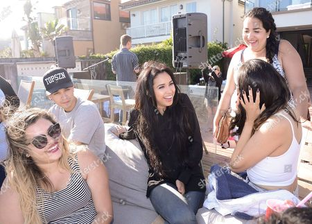 Singer Jasmine V meets and talks with fans at the JustFab Beach House presented by Gevalia Iced Coffee with Almond Milk on Monday, July 6, in Malibu, Calif