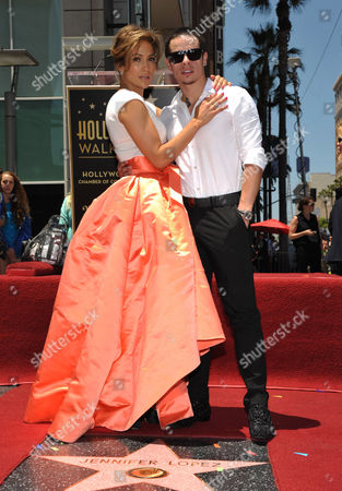 """Jennifer Lopez, left, and Beau """"Casper"""" Smart pose with her new star on the Hollywood Walk of Fame, in Los Angeles"""