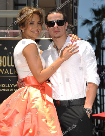 """Jennifer Lopez, left, and Beau """"Casper"""" Smart pose with her new star on the Hollywood Walk of Fame on in Los Angeles"""