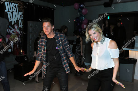 """IMAGE DISTRIBUTED FOR UBISOFT - """"The Bachelorette"""" winner Jef Holm, left, dances to Ubisoft's Just Dance 4 with party host Ashley Benson at the launch party on in Los Angeles.Just Dance 4 hits store shelves on Tuesday, Oct. 9, 2012"""