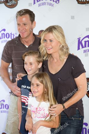 David Sanov, from left, Benjamin Sanov Megan Sanov and Alison Sweeney arrive at the event to celebrate the return of the Ghostrider at Knott's Berry Farm, in Buena Park, Calif