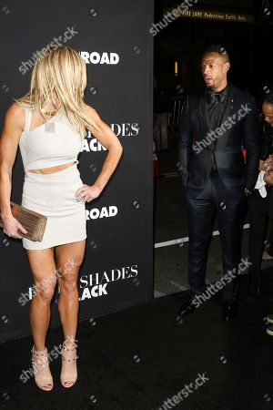 "Torrie Wilson, left, and Marlon Wayans attend the LA Premiere of ""50 Shades of Black"" held at Regal L.A. Live, in Los Angeles"