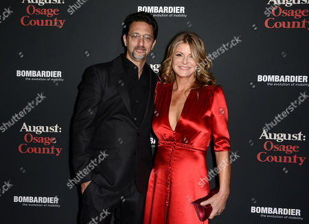 "From left to right, actor Grant Heslov and wife Lysa Heslov arrive at the premiere of the feature film ""August: Osage County"" Regal Cinema L.A. Live on in Los Angeles"