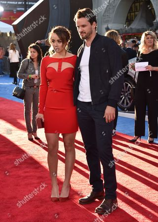 """Chloe Bennet, left, and Austin Nichols arrive at the Los Angeles premiere of """"Captain America: Civil War"""" at the Dolby Theatre on"""