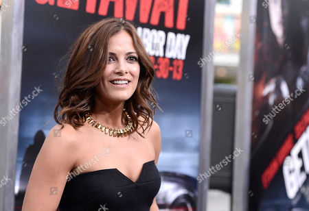 "Actress Rebecca Budig arrives on the red carpet at the premiere of the feature film ""Getaway"" at the Regency Village Theater on in Los Angeles"