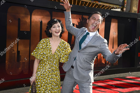 Kaho Minami, left, and Ken Watanabe, arrive at the LA premiere of 'Godzilla' at Dolby Theatre on in Los Angeles