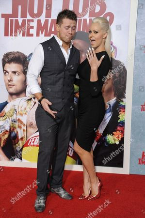 """Mike 'The Miz' Mizanin, left, and Maryse Ouellet arrive at the LA Premiere Of """"Hot Tub Time Machine 2"""" held at the Regency Village Theater, in Los Angeles"""