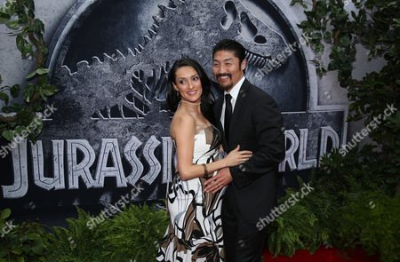 """Mirelly Taylor, left, and Brian Tee arrive at the Los Angeles premiere of """"Jurassic World"""" at the Dolby Theatre on"""