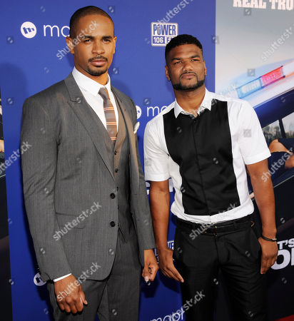 """Damon Wayans Jr., a cast member in """"Let's Be Cops,"""" poses with Damien Dante Wayans at the premiere of the film on in Los Angeles"""
