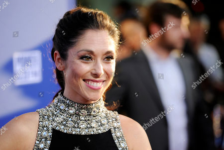 "Jessica Luza, a cast member in ""Let's Be Cops,"" poses at the premiere of the film on in Los Angeles"