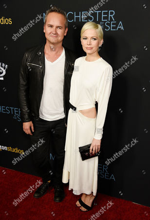 """Roy Price, left, head of Amazon Studios, poses with Michelle Williams, a cast member in """"Manchester by the Sea,"""" at the premiere of the film at the Samuel Goldwyn Theater, in Beverly Hills, Calif"""