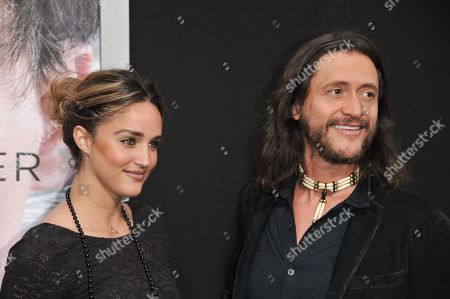 """Clifton Collins Jr., right, and, Megan Ozurovich arrive at the LA Premiere Of """"Transcendence"""", in Los Angeles"""