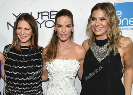 From left, producer Alison Greenspan, producer/actress Hilary Swank and producer Molly Smith arrive at the premiere of 'You're Not You' at The Landmark, in Los Angeles