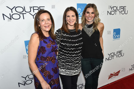 "From left, Producers Denise Di Novi, Alison Greenspan and Molly Smith arrive at the premiere of ""You're Not You"" at The Landmark, in Los Angeles"